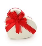 Gift box and red ribbon. Isolated Stock Photos