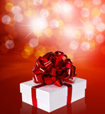 Gift in box with red ribbon Stock Image