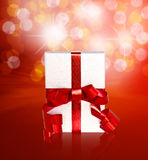 Gift in box with red ribbon Stock Photography