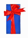 Gift box with red ribbon. Red ribbon wrapped gift isolated on white background Stock Image