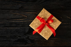 Gift box with red ribbon Stock Photography