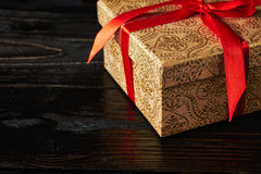 Gift box with red ribbon Royalty Free Stock Photos