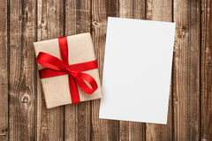 Gift box with red ribbon and blank greeting card Stock Photo