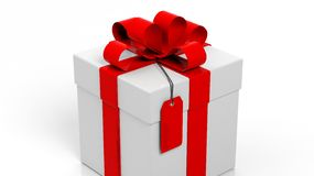 Gift box with red ribbon and blank tag Stock Image