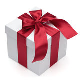 Gift box with red ribbon and bow. Gift box with red ribbon and bow, isolated on the white background, clipping path included Royalty Free Stock Image