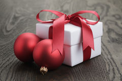 Gift box with red ribbon bow and christmas balls Stock Photo