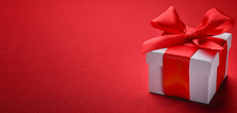 Gift box with red ribbon bow Royalty Free Stock Photography
