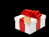 Gift box with red ribbon bow decoration on black background Stock Image