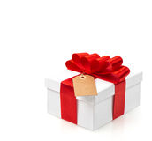 Gift box with red ribbon bow decoration on white background Stock Images