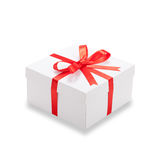 Gift box with red ribbon and bow Stock Photos