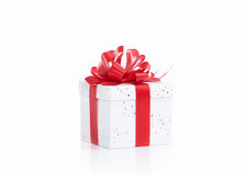 Gift box with red ribbon bow, isolated on white Royalty Free Stock Image