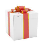 Gift box with red ribbon bow and label Royalty Free Stock Photography