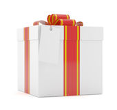 Gift box with red ribbon bow and label Stock Images