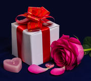 Gift Box with red Ribbon, Bow, Rose and Candle. Royalty Free Stock Images