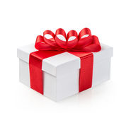 Gift box with red ribbon bow and tag isolated on white Royalty Free Stock Photo