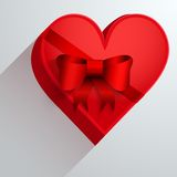Gift box with red ribbon in the form of heart. Stock Images