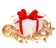 Gift box with red ribbon and golden balls Royalty Free Stock Photos