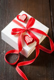 Gift box with red ribbon Royalty Free Stock Photography