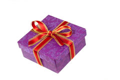 A gift box,with red ribbon,isolated on white Stock Photos