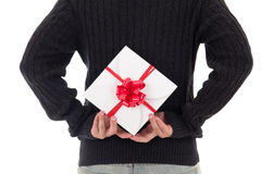 Gift box with red ribbon in male hands Stock Photos