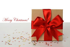 Gift box with red ribbon and Marry Christmas text Stock Image