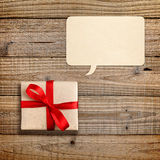 Gift box with red ribbon and speech bubble Stock Image