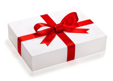 Gift box with red ribbon and teg. Single box with red ribbon and gift card on white backgroun Royalty Free Stock Photos