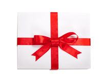 Gift box with red ribbon and teg. Single box with red ribbon and gift card on white backgroun Stock Photo
