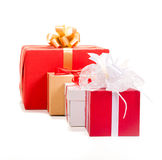Gift box with red ribbon and teg Stock Photos