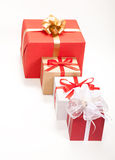 Gift box with red ribbon and teg. Single box with red ribbon and gift card on white backgroun Stock Image