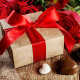 Gift box with a red ribbon Stock Photos