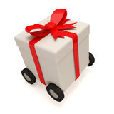 Gift Box with Red Ribbon on wheels Royalty Free Stock Image