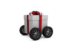 Gift box with red ribbon on wheels Royalty Free Stock Images