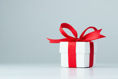 Gift box. With red ribbon on white background