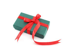 green gift box with red ribbon Stock Photos