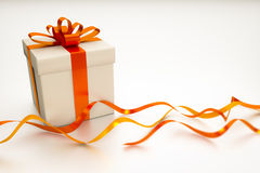 Gift box with red ribbon Royalty Free Stock Images