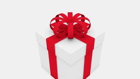 Gift box with red ribbon on white stock video footage