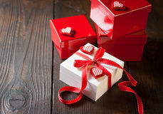 Gift box with red ribbon Stock Images