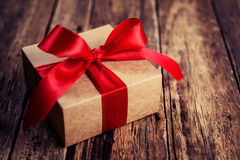 Gift box with a red ribbon Royalty Free Stock Photography