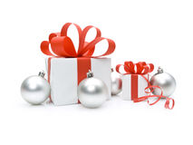 Gift box with red ribbons and Christmas baub Royalty Free Stock Photo