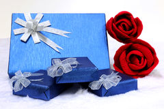 Gift box and red rose. On a flannel background Stock Photos