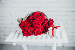 Gift box and red roses. Present on Valentine's Day for woman Stock Images