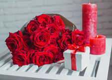 Gift box and red roses. Present on Valentine's Day for woman Royalty Free Stock Image