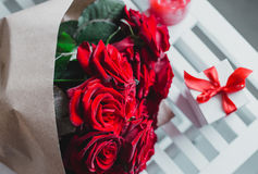 Gift box and red roses. Present on Valentine's Day for woman Royalty Free Stock Photos