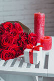 Gift box and red roses. Present on Valentine's Day for woman Royalty Free Stock Images