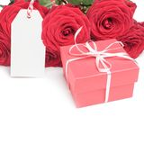 Card, box and roses on white Royalty Free Stock Photography