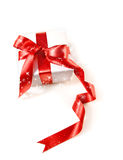 Gift box  with red satin ribbon Royalty Free Stock Photo
