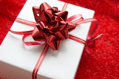 Gift box with red satin ribbon Stock Image