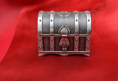 Gift Box on Red Silk cloth Stock Photos