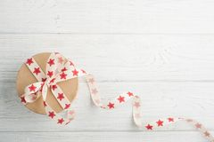 Gift Box with red star ribbon Royalty Free Stock Photos